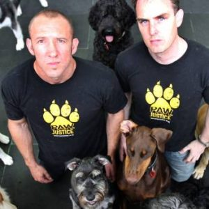 Paw Justice owners with dogs
